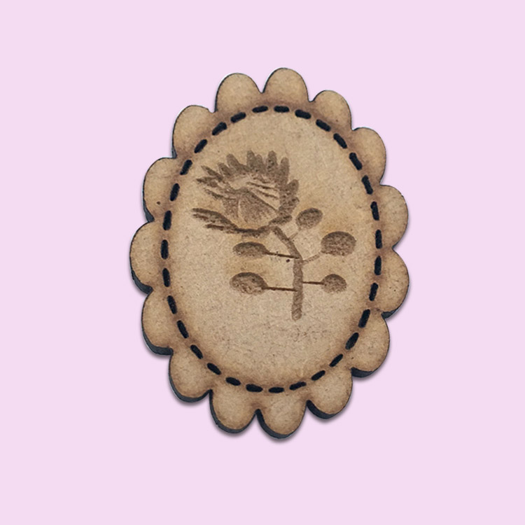 oval wooden protea badge