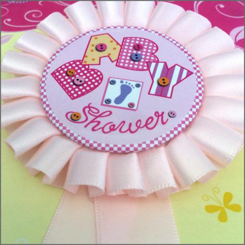 Pink baby shower rosette badge